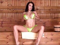 Lime green swimsuit looks sexy on Charley Atwell