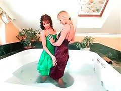 Girls in comely dresses have a bath together
